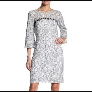 Taylor lace white and black dress, bell sleeves.